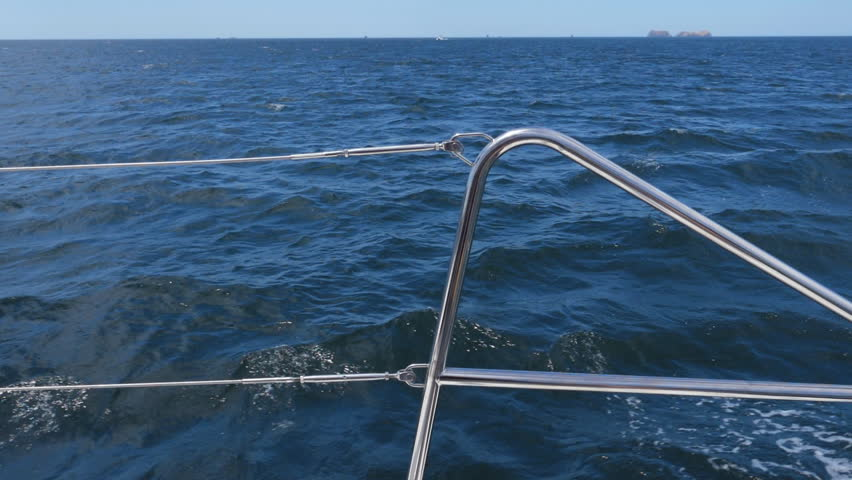 Slow motion detail of railing on sailboat with ocean moving past in background. | Shutterstock HD Video #1027637756
