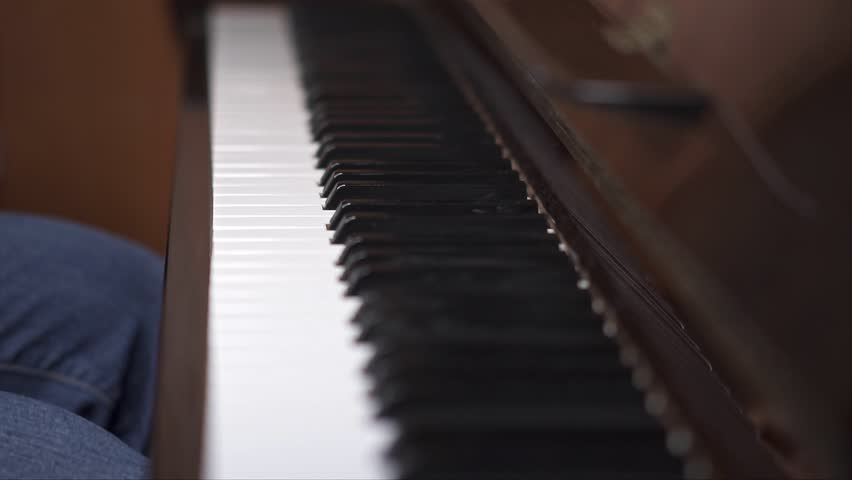 Musician plays piano, Close up shot with shallow depth of field | Shutterstock HD Video #1027661576