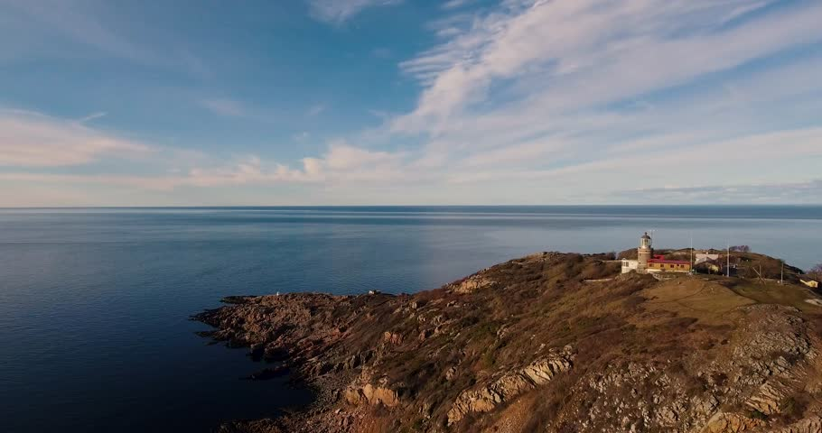Drone footage: Lighthouse and coast landscape - Kullaberg, Sweden | Shutterstock HD Video #1027668866