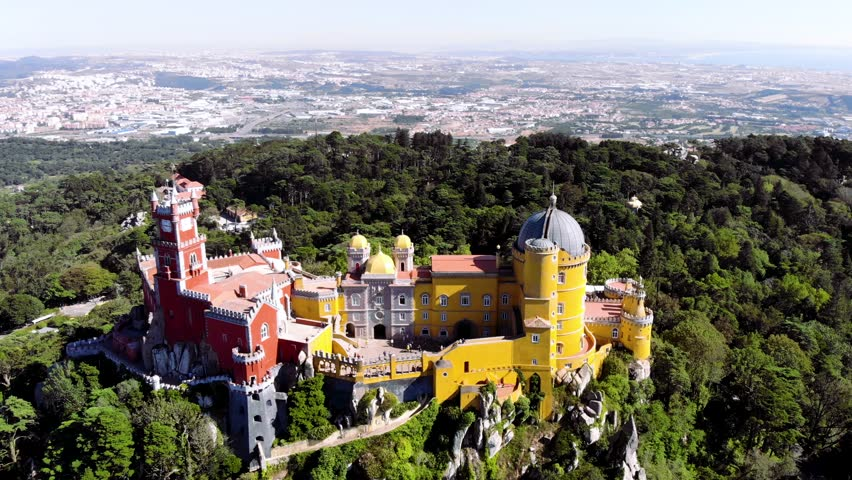 Aerial view of the beautiful Pena Palace (Palacio da Pena) in Sintra, Portugal; Concept for travel in Portugal | Shutterstock HD Video #1027729076