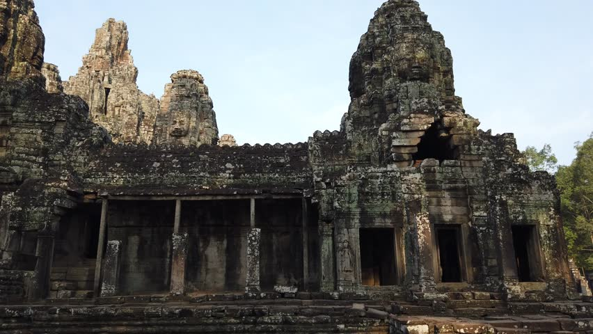 Huge stone faces on the towers of the ancient temple. Bayon. Angkor. Cambodia #1027762346