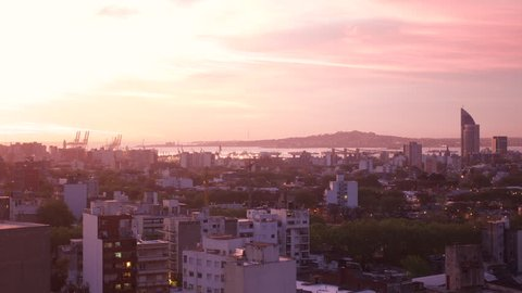 Pink sky time lapse of Montevideo Uruguay port at sunset