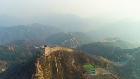Great Wall of China and Green Mountains in Haze. Badaling. Aerial View. Drone Flies Sideways and Upwards