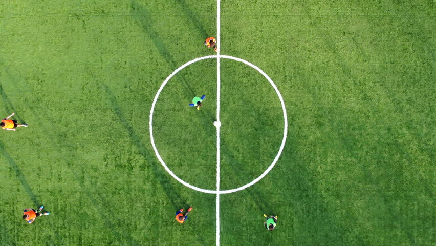The beginning of a football match and scoring a Goal. Aerial shot of a football match the view from the top #1027783826