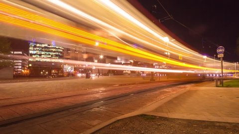 Timelapse of Salford Quays MediaCity Manchester city urban trams at night.