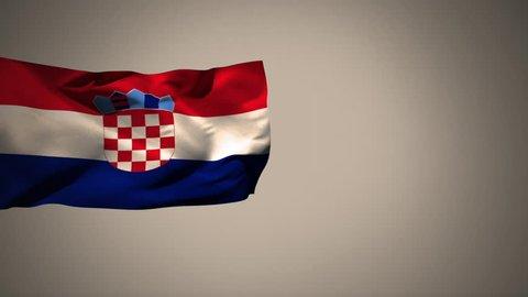 Croatian flag waving against a grey background