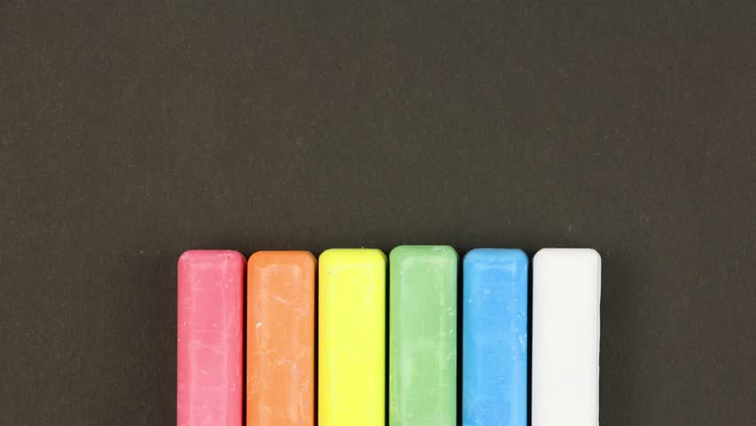 Six colored children crayons on black background lined in a row, crayons come out  randomly, closeup, loop video, stopmotion animation, kindergarten education concept   Shutterstock HD Video #1027924286