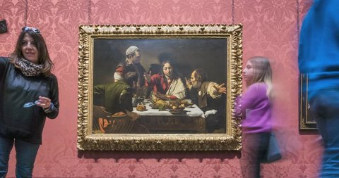 London, UK – April 18 2019: timelaps in front of the painting by Caravaggio,  The supper at Emmaus, on National museum
