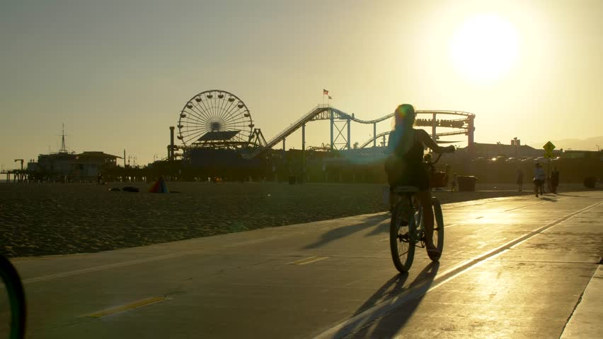 Los Angeles, CA / USA - July 17, 2017: Tourists on Bike Path in front of the Santa Monica Pier #1027938026