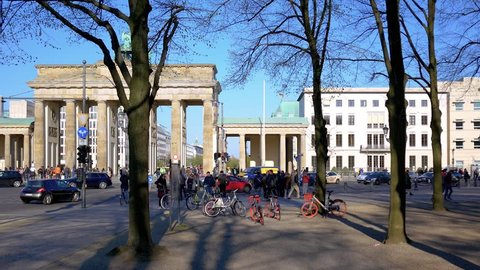 BERLIN, GERMANY - APRIL 15, 2019: Tourists And Traffic At Brandenburger Tor, Brandenburg Gate, In Berlin, Germany In Spring