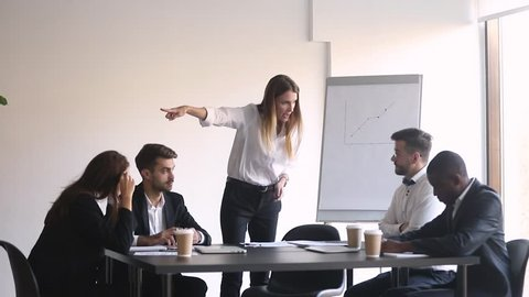 Male worker get scolded fired by angry female boss leaving office team meeting and quit, mean business woman manager firing shouting at stressed man employee dismiss incompetent intern in boardroom