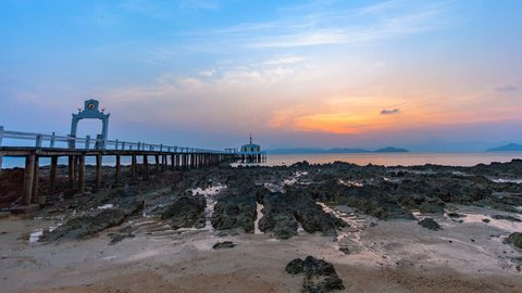 timelapse sunrise above Buddha on the pier at Phayam temple in Phayam island. landmark at Hin Kao gulf in Phayam island Ranong Province Thailand