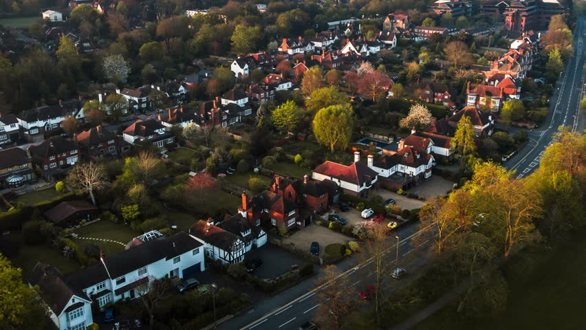 Aerial Shot of classic British housing estate, English houses and homes from above    Shutterstock HD Video #1028043416