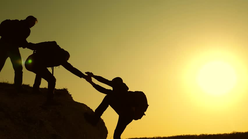 Climbers silhouettes stretch their hands to each other, climbing to the top of hill. travelers climb one after another on the rock. teamwork of business people. A team of businessmen is going to win. | Shutterstock HD Video #1028049086