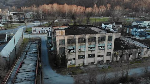 Aerial paralax drone shot of abandoned building. Building is located in the town of Ronceverte, West Virginia.