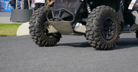 Szczecin, Poland - 10 22 2018: 4x4 Quad Bike motor atv wheel spinning from slowly driving