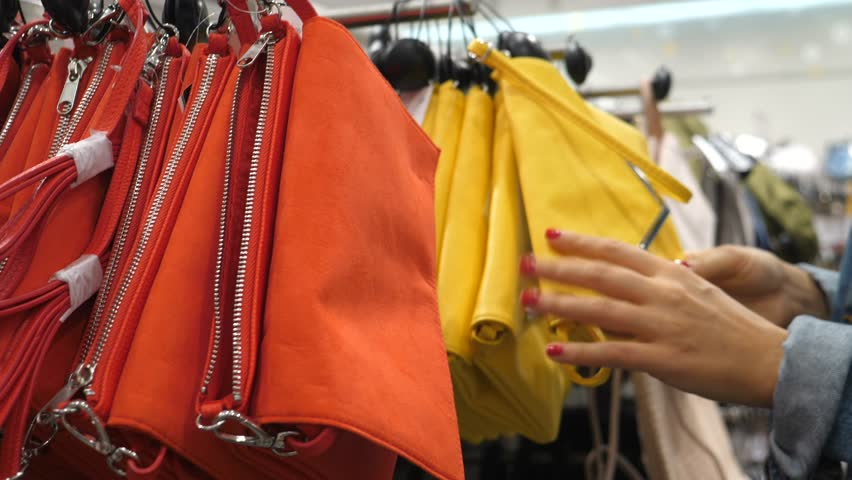 Female Customer Choosing Faux Leather Bags In Store. Shopping Concept. | Shutterstock HD Video #1028136326