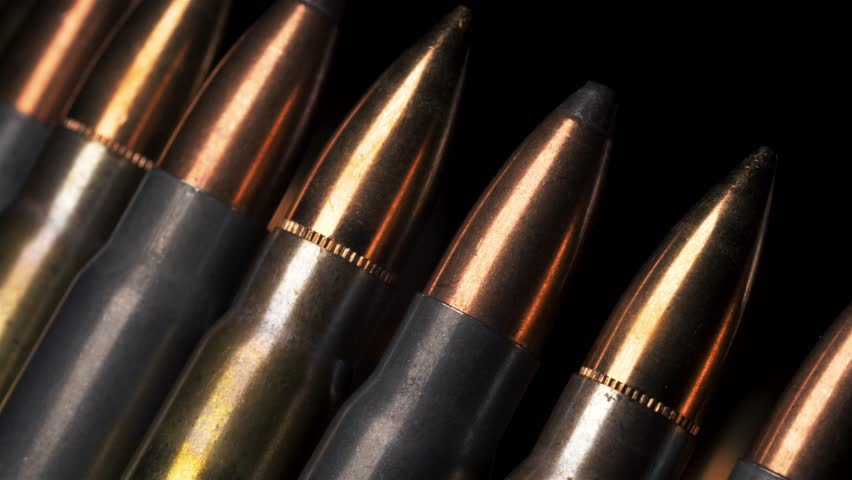 Macro detailed shot of rifle ammunition rotating left at an angle with a black background. | Shutterstock HD Video #1028162846