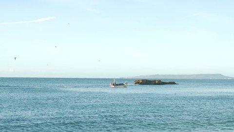 Boating through sea in Dorset UK
