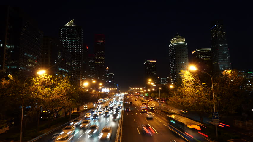 Beijing, China - April 15, 2019: Cars travel on the road of the city's Central Business Area (CBD) in the evening.