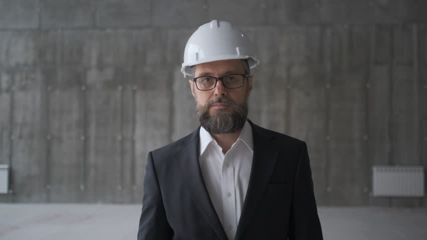 Professional people at work, portrait of architect with safety helmet in construction site, looking at camera | Shutterstock HD Video #1028237906