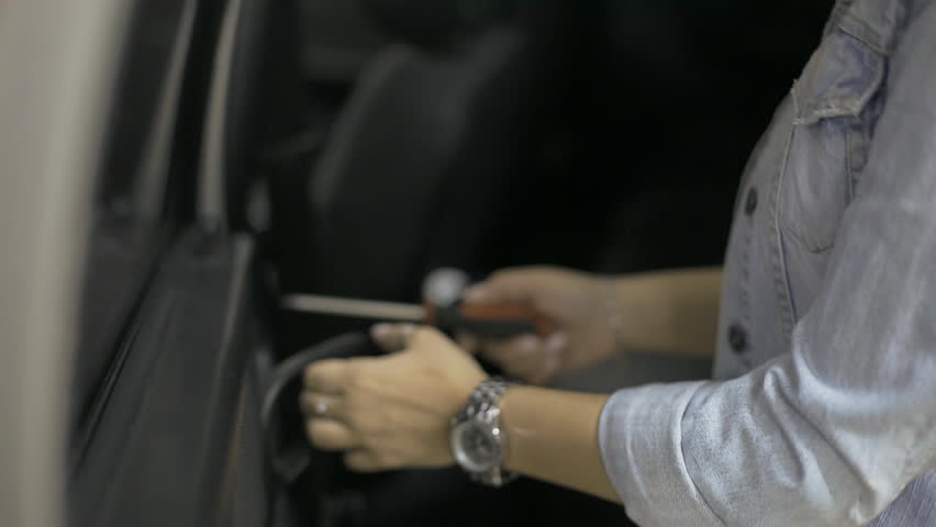 Feminized girl master service the blonde working on the old car in to the mechanic for repair | Shutterstock HD Video #1028302466
