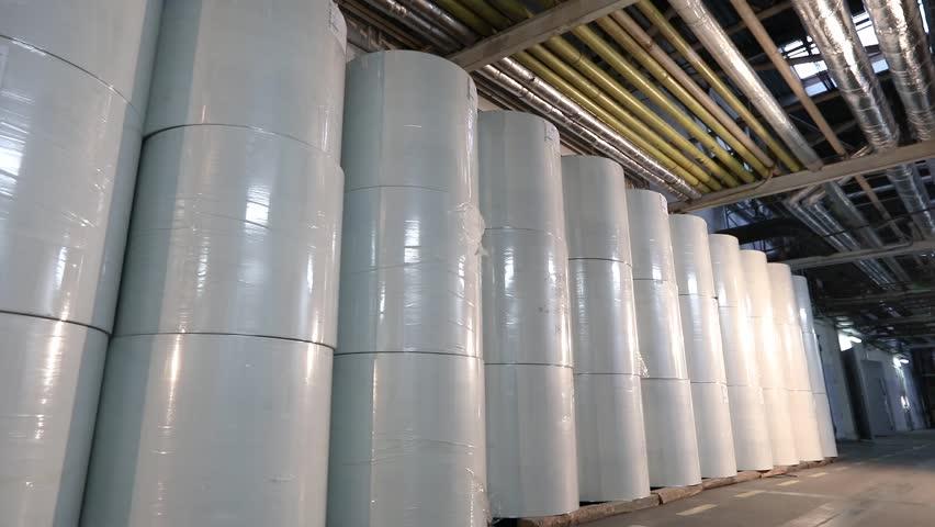 White barrels in the factory warehouse, white barrels stand in a row in the warehouse. Large white barrels in stock | Shutterstock HD Video #1028307626