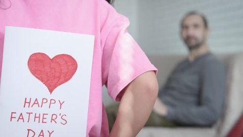 Happy father's day. A little girl gives her father a surprise.