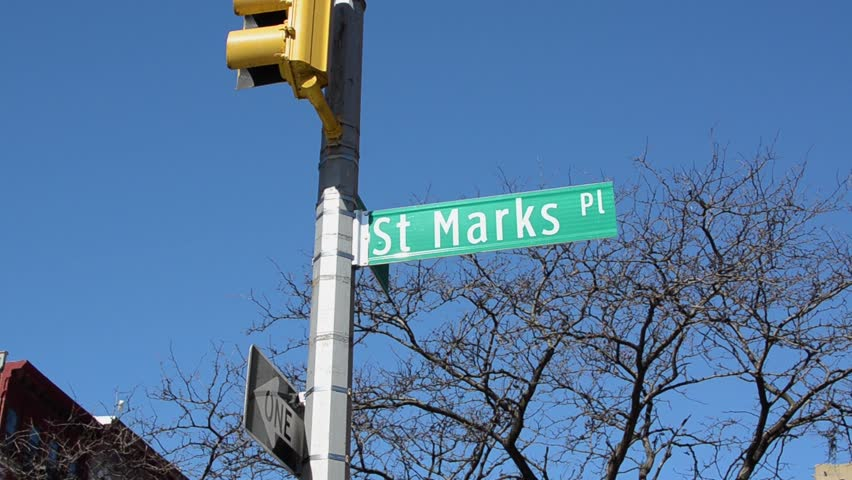 Iconic street signs of New York City. Know as the hip, notorious area know as St Marks Place. Karaoke, tattoo shops and delicious foodie spots. | Shutterstock HD Video #1028466596