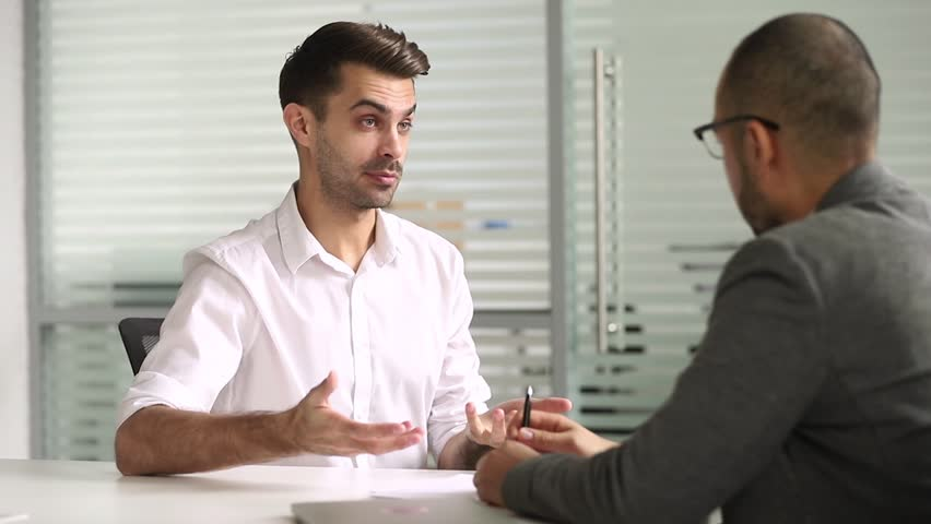 Male advisor salesman talking with client handshaking closing deal at business meeting, hr hire applicant at job interview, customer thanking manager for advice shake hands make agreement concept