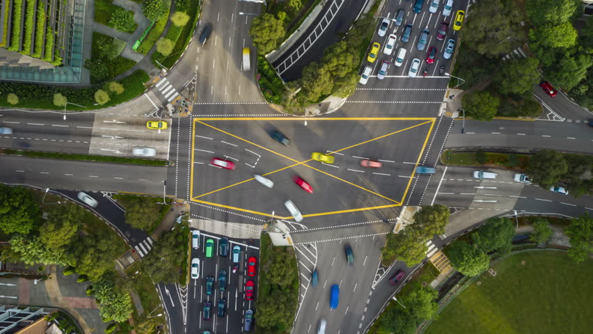 Sunny day singapore city traffic street crossroad aerial topdown panorama 4k timelapse   Shutterstock HD Video #1028547806