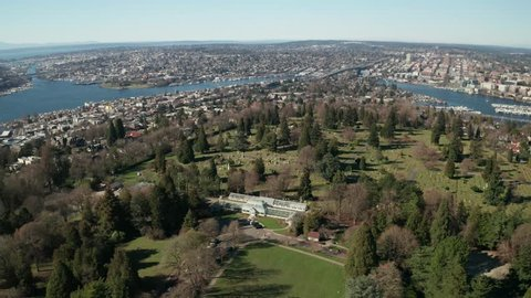 Aerial / drone video of Volunteer Park, University of Washington, Lake Union, Lake Washington and Seattle from Capitol Hill and Eastlake