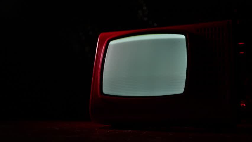 Old vintage red TV with white noise on dark toned foggy background. Retro old Television receiver no signal. Selective focus | Shutterstock HD Video #1028571596