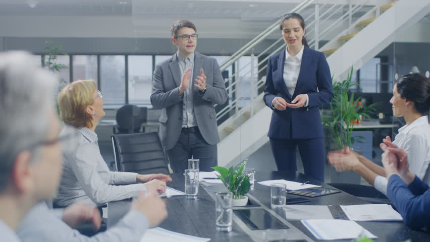 In the Corporate Office Meeting Room: Two Young and Ambitions Start-up Creators Give a Speech to a Group of Venture Capital Investors, Businesspeople Cheer and Applaud in Successful Agreement | Shutterstock HD Video #1028612276