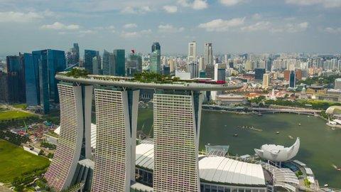SINGAPORE - FEBRUARY 4 2019: city sunny day flight over famous hotel marina bay aerial panorama 4k timelapse circa february 4 2019 singapore.