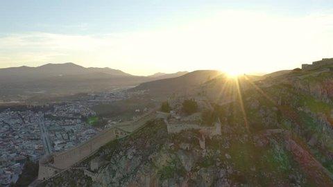 Sunrise over Nafplio town and Palamidi Castle, beautiful aerial establishing shot 4k