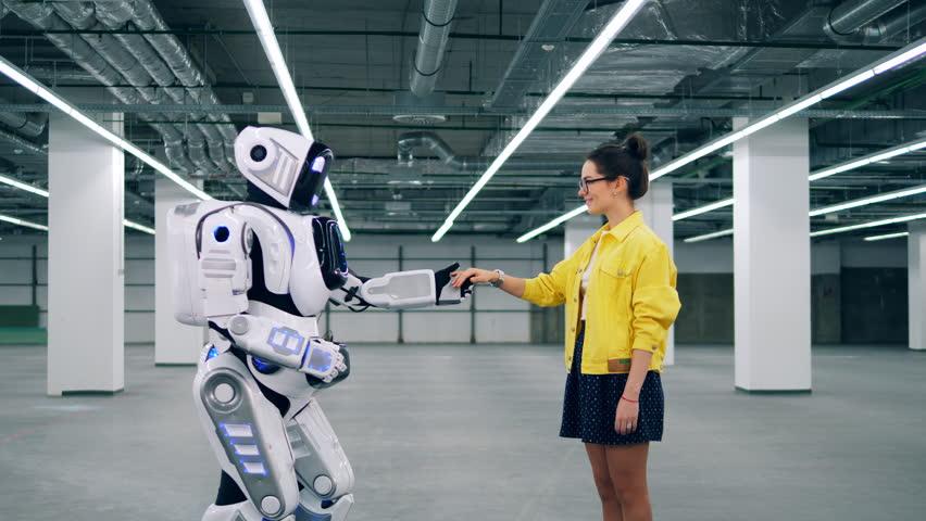 Human-like cyborg is taking a girl's hand | Shutterstock HD Video #1028673266