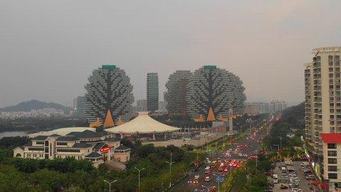 sanya city famous hotel complex riverside theatre traffic street aerial panorama 4k hainan china