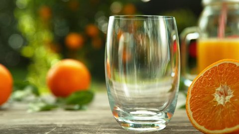 Super slow motion of pouring orange juice into glass. Filmed on high speed cinema camera, 1000 fps.