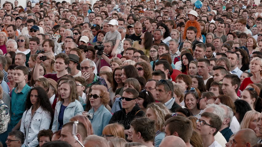 Minsk, Belarus - Jun 30, 2017: The crowd happily applauds during the music in the open air concert in the town square. | Shutterstock HD Video #1028767616