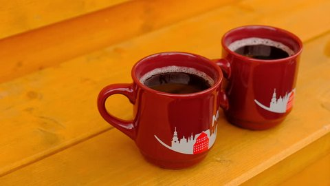 Two Hot Steaming Gluhwein Mugs at a Christmas Market in Monschau, Germany