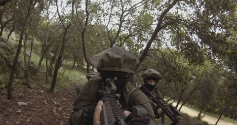 Weapon GoPro POV footage of a squad of Israeli commando soldiers during combat