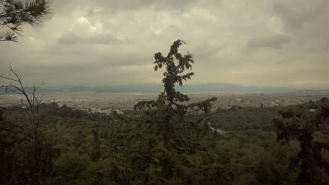 4K Camera Pan right at Parthenon, Acropolis, Athens, Attica, Greece /panoramic view of the city and old town