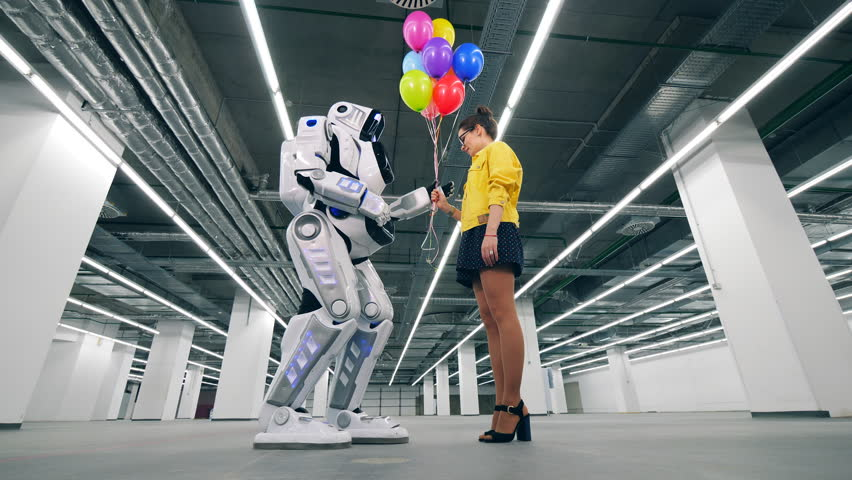 Downside view of a cyborg accepting balloons from a lady | Shutterstock HD Video #1028988326