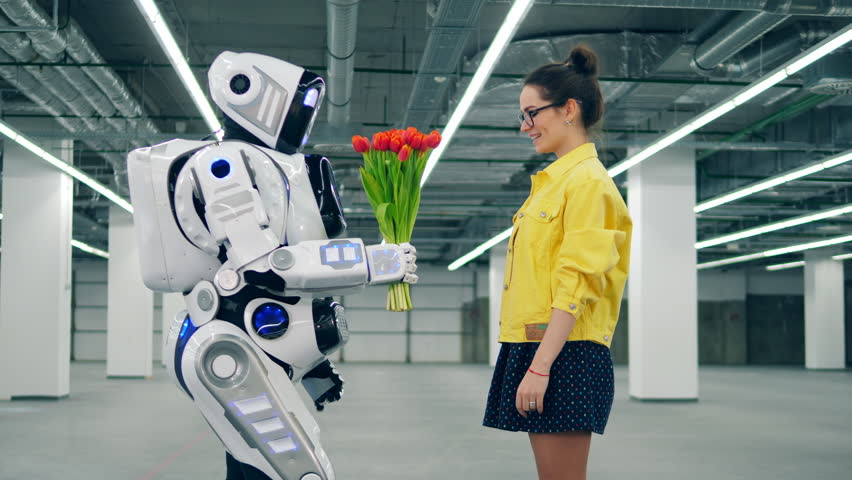 Young lady is getting tulips from a robot | Shutterstock HD Video #1028988506