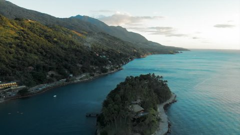 Aerial: Secluded Island in Archipelago, Aquamarine Water During Sunset in Ilhabela, Brazil
