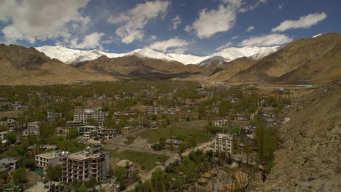 Medium high-angle still shot of Leh town buildings and surrounding Hs, Ladakh, India.