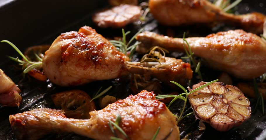 Grilled chicken. Grilled chicken legs, drumsticks with addition garlic, lemon and rosemary on grill plate. Grill food, 4K | Shutterstock HD Video #1029151586