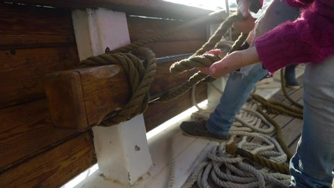 Sailing, Crew Securing Rope With Sailing Knot. Slow Motion Close Up.