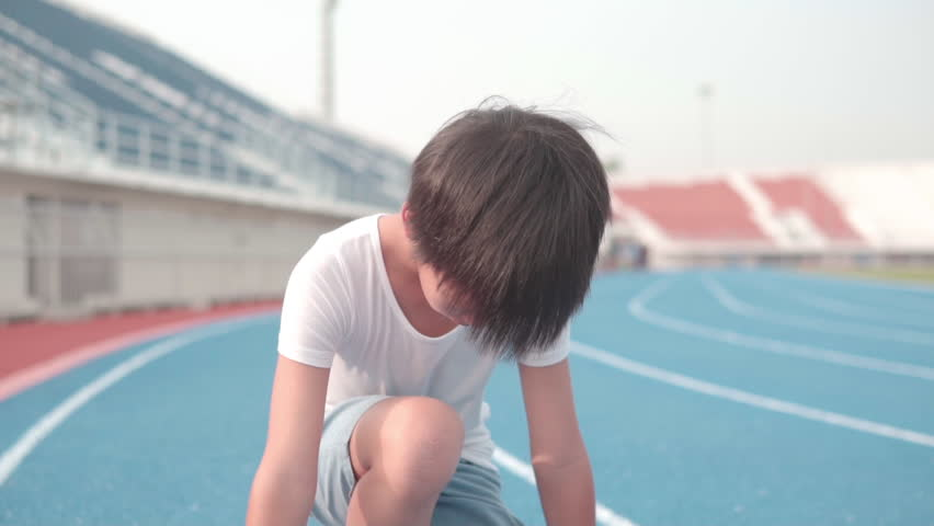 Close up slow motion young Asian boy prepare to run and look forward   Shutterstock HD Video #1029291446